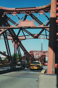 North Avenue is 4 lanes, mostly, except at a number of choke points of which the old bridge was one. The lanes were generous for 1905 but amounted to two one-and-a-half lanes in 2004. Photo by Roman