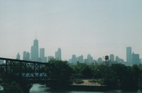 Looking south from the bridge at Goose Island and the Chicago skyline. The bridge in the picture was an active railroad bridge in 2004 but there are no longer any customers on Goose Island in 2018. Photo by Roman